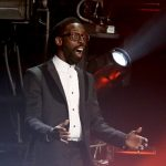 "Tye Tribbett reacts on stage as he is announced the winner for the best gospel album award for ""Greater Than [Live]"" at the pre-telecast of the 56th annual GRAMMY Awards on Sunday, Jan. 26, 2014, in Los Angeles. (Photo by Matt Sayles/Invision/AP)"