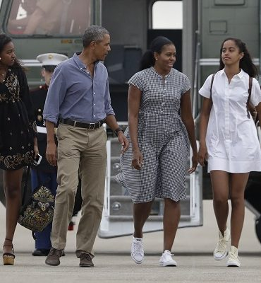 """President Barack Obama with first lady Michelle Obama and their daughters Malia, right, and Sasha walk on the tarmac to board Air Force One at Air Station Cape Cod in Mass., Sunday, Aug. 21, 2016. Obama is returning from vacation rested and ready for a busy fall, including pressing Congress for money to protect against the Zika virus and fending off lawmakers' attacks over the administration's $400 million """"leverage"""" payment to Iran. (AP Photo/Manuel"""