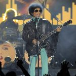 FILE - In this May 19, 2013, file photo, Prince performs at the Billboard Music Awards at the MGM Grand Garden Arena in Las Vegas. In a newspaper report published Wednesday, May 4, 2016, Prince had arranged to meet a California doctor to try to kick an addiction to painkillers shortly before his death. (Photo by Chris Pizzello/Invision/AP, File)