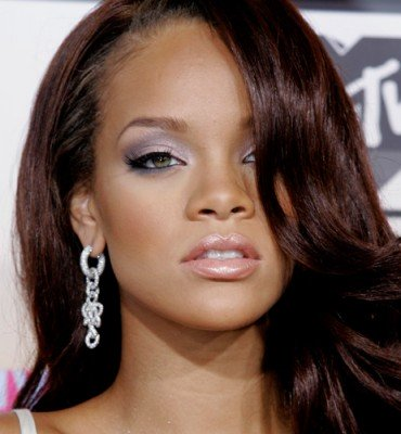 The wife of Rihanna's former bodyguard is suing her