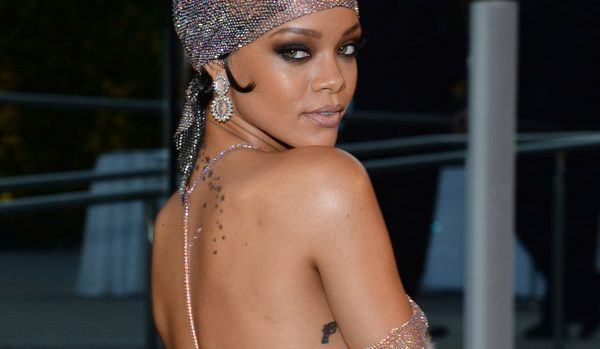 Rihanna had to shield her boobs as she spilled out of a plunging gown