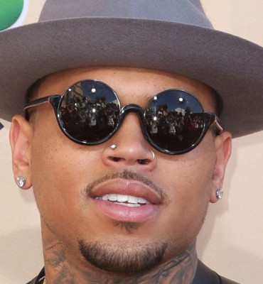 Chris Brown settled a lawsuit with a woman that accused him of attacking her
