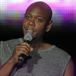 FILE - This Sunday, July 6, 2014 file photo, Dave Chappelle performs at the Essence Festival in New Orleans. Assistant District Attorney Anastasia Martin on Monday, July 27, 2015 told the Santa Fe New Mexican that jury selection is scheduled for Sept. 23, 2015 for the trial of Christian Englander, the 31-year-old man accused of throwing a banana peel at Chappelle during a New Mexico performance. (AP Photo/Gerald Herbert, File)