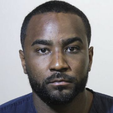 Nick Gordon has been charged with hanging out with his girl