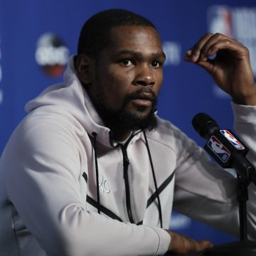 Kevin Durant was held back from a Cavs fan outside the team hotel